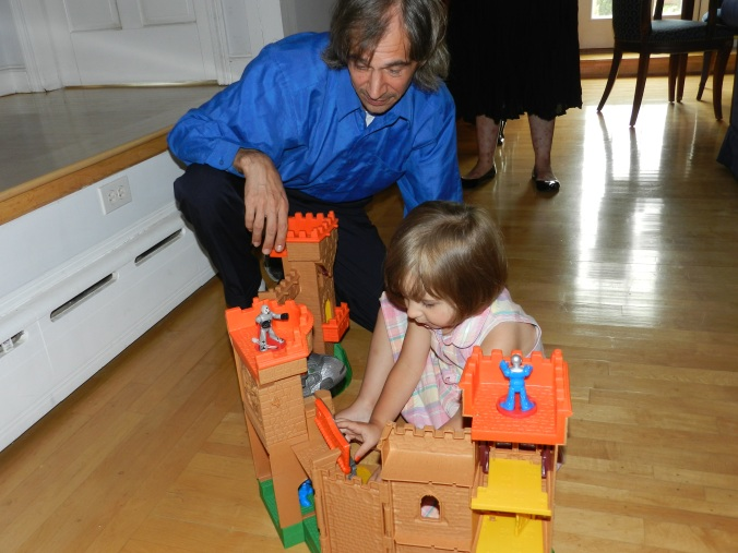 Angel and Daddy play with the castle